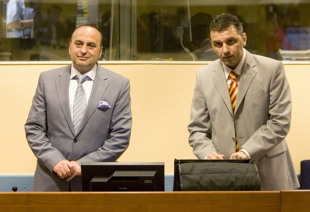 Former Macedonian Interior Minister Ljube Boskovski (L) and former police chief, Johan Tarculovski, arrive in the courtroom of the UN war tribunal in The Hague July 10, 2008, to hear their verdict on charges of murder, wanton destruction of civilian property and cruel treatment against Albanians in the village of Ljoboten in 2001. Tarculovski is convicted for 12 years imprisonment, Boskovski was cleared of the charge. REUTERS/Olaf Kraak/ANP/Pool (Netherlands)